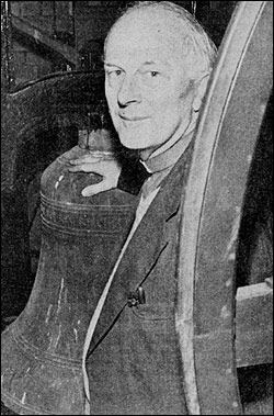 Photograph of Rev Edward Pitt with 335-year-old bell