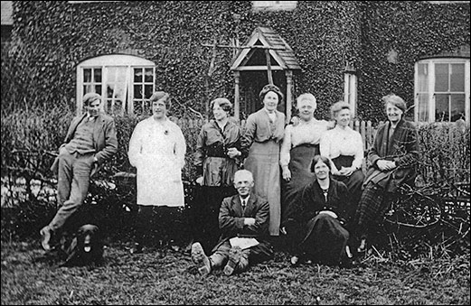 Photograph showing exterior of Downings Lodge with members of the family c1920