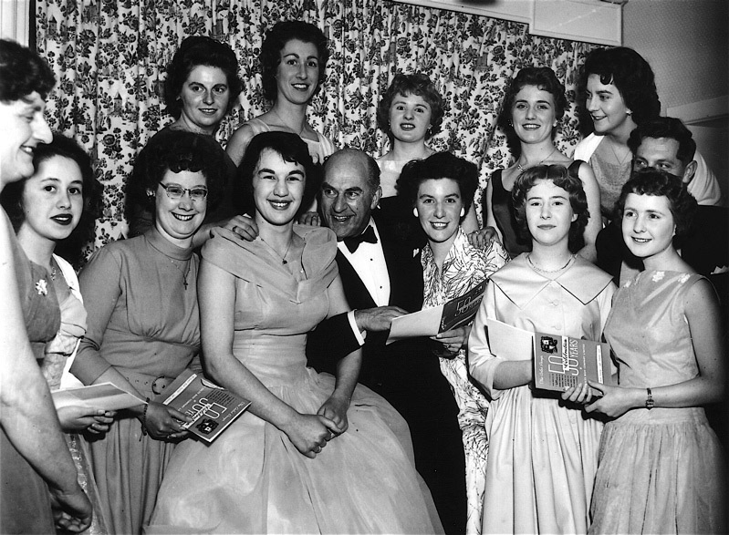 50 years Anniversary Celebration at Wicksteed Park showing Office Staff with the radio entertainer, Kenneth Horne