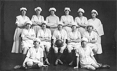 Photograph of Coles Boot Ladies Football Team 1920s.  Left to Right Back Row: Mrs G Williams, A Moisey, E Perkins, E Troop, I Rixon, D Dickman  Centre Row: E Larratt, L Clark, M Underwood, I Allen and L Larratt  Front Row: J Hume and E Austin