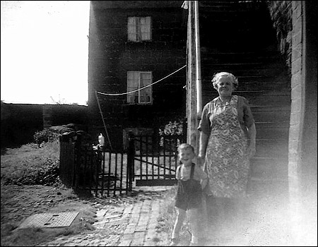 Myself and Great Aunt Annie at the bottom of our stairs, Nan Robinson's house in background 1958