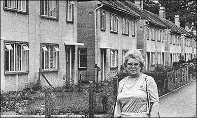 Photograph of Councillor Marian York in front of the Orlit houses