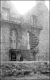 Spiral staircase on side of Cottage Homes