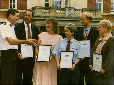 Photograph showing award winners honoured by police with Pam Mills 3rd from left