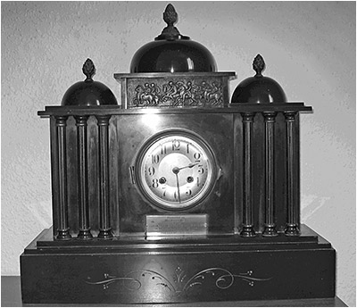 The black mantle clock presented to Edward when he retired as President of the Burton Latimer Co-Operative Society