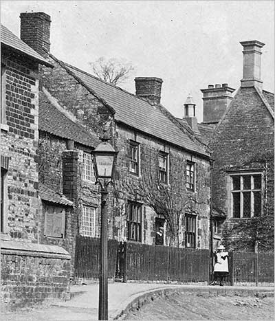This photograph, taken circa 1910, shows Talbutt's bakehouse next to the Jacobean schoolhouse. The building was demolished c.1969.