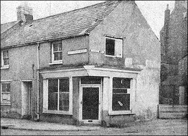 "Photograph showing the corner shop as it was before the ""face lift"""