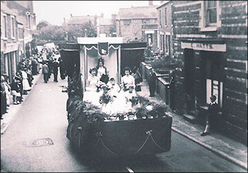 The 1956 Carnival Parade passing Watts' shop in 1 Kettering Road