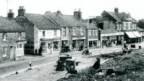 Road widening in 1961 showing the row of shops later to be part of the Co-op.