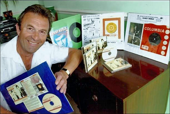 Barry Noble with memorabilia