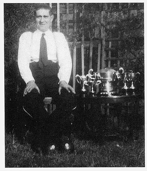 Freddie Mann with some of his bowls trophies - 1950