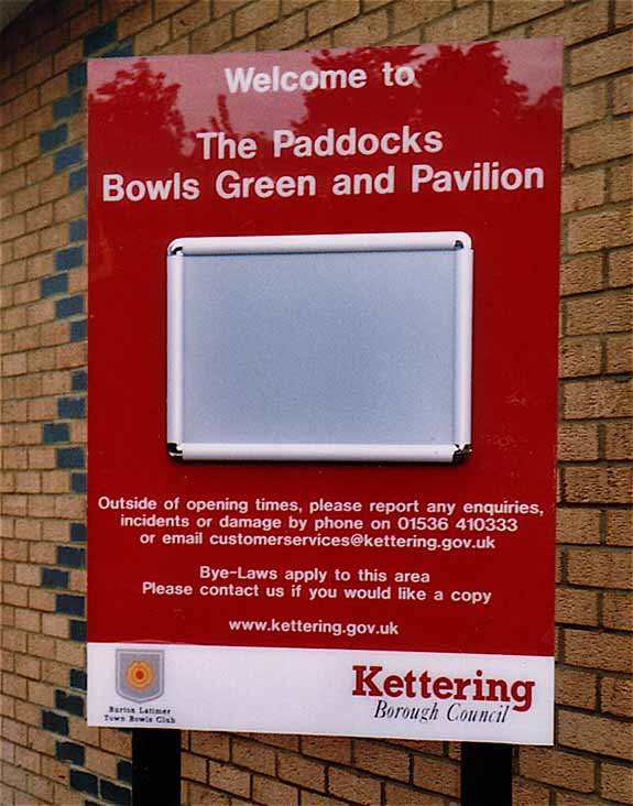 Kettering Borouogh Council sign for The Paddocks, Bowling Green and Pavilion