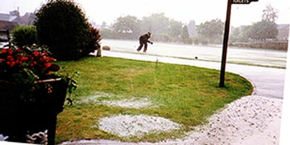 9 July 1993 Flooded Bowling Green - Robert Gater (Greenkeeper) collecting woods after a thunderstorm