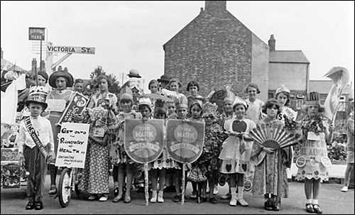 Some of the children who participated in the Co-operative Society parade c.1938.  This photo was taken at the junction of Victoria Street and Station Road
