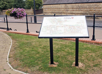 Photograph of the illustrated panel situated in Millennium Gardens close to the site of the former Denton's Farm at bottom of Churchill Way
